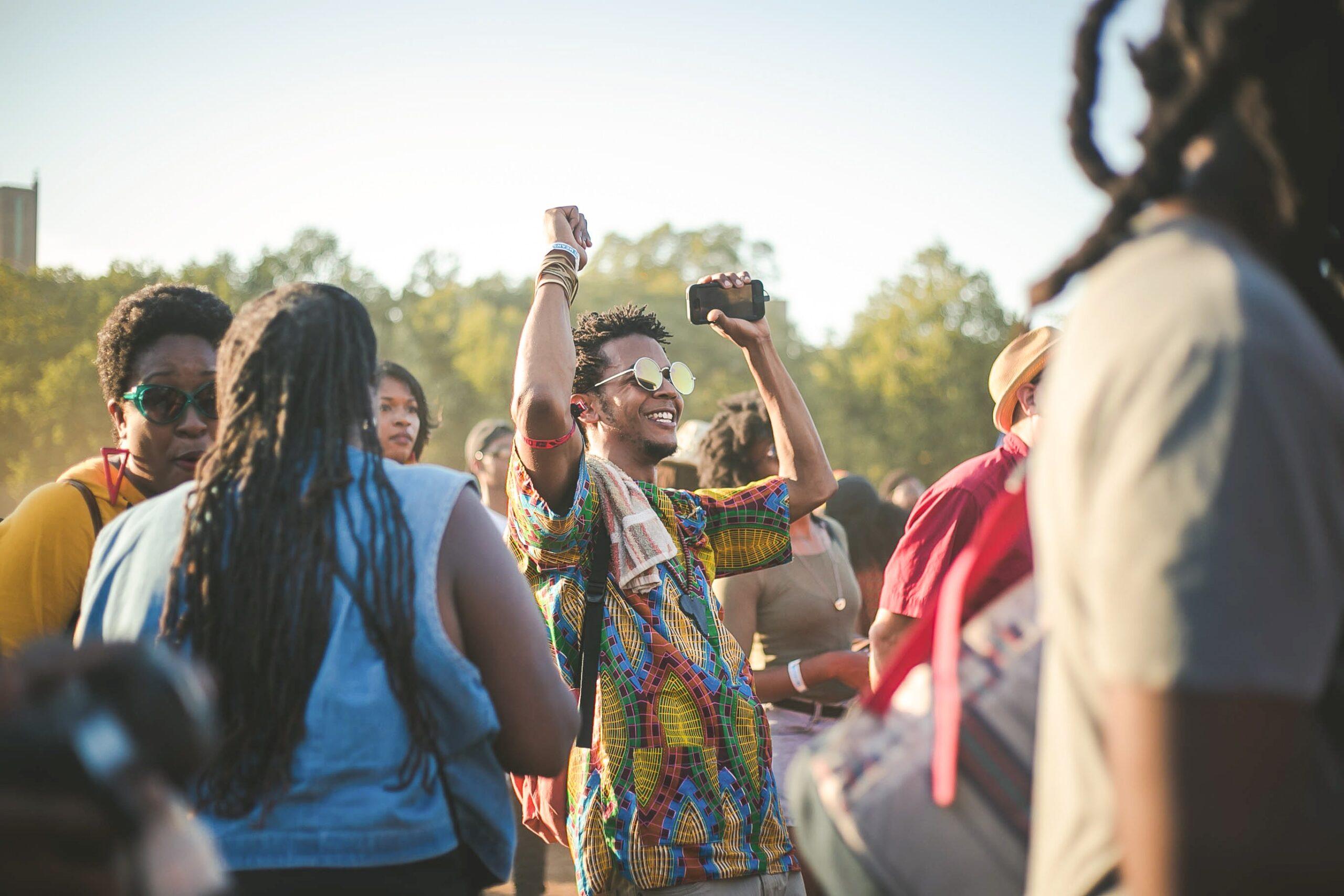 Man dancing in festival crowd