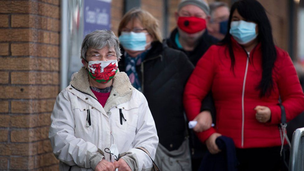 Woman in welsh flag face mask