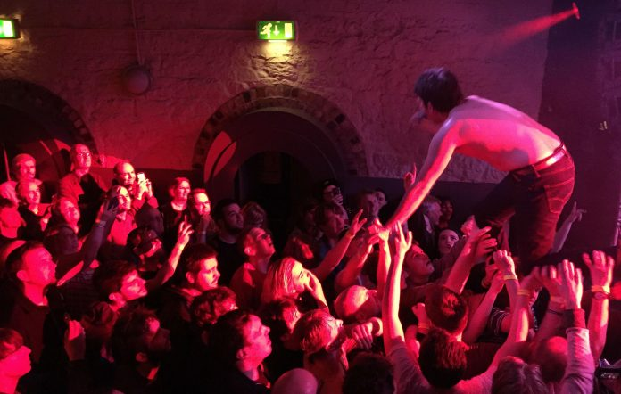 Crowdsurfing at a grassroots venue.