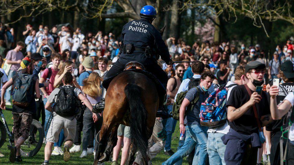 Police in Belgium riding a horse