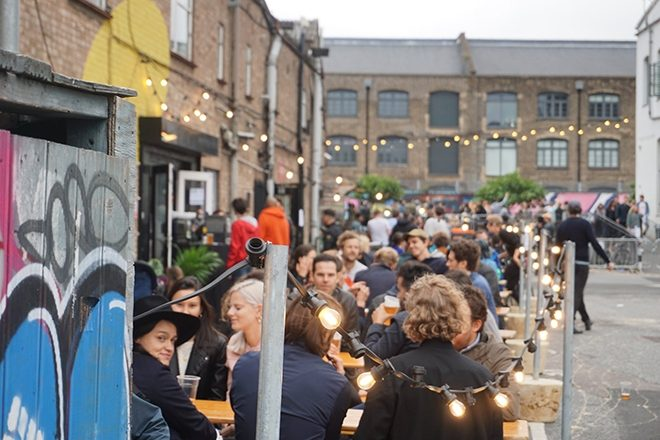 Revellers in the outdoor area of London's Colour Factory