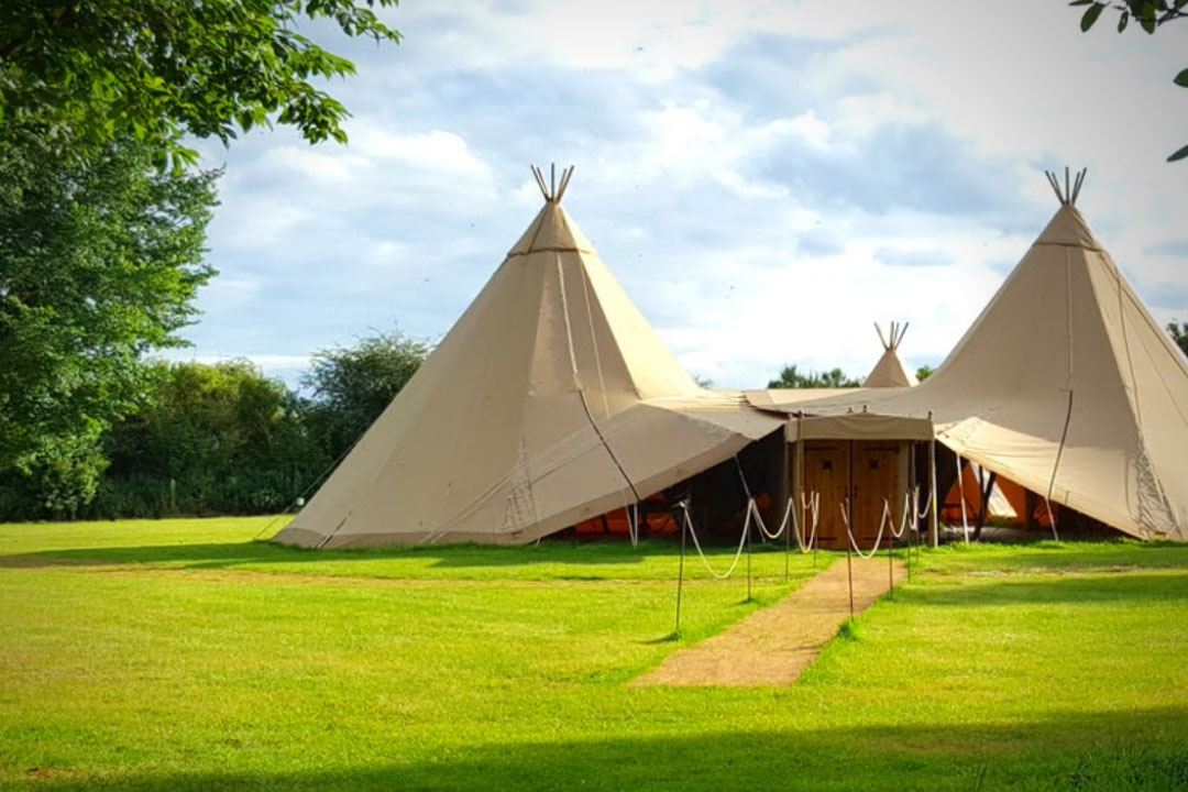 Large glamping tipi in a field