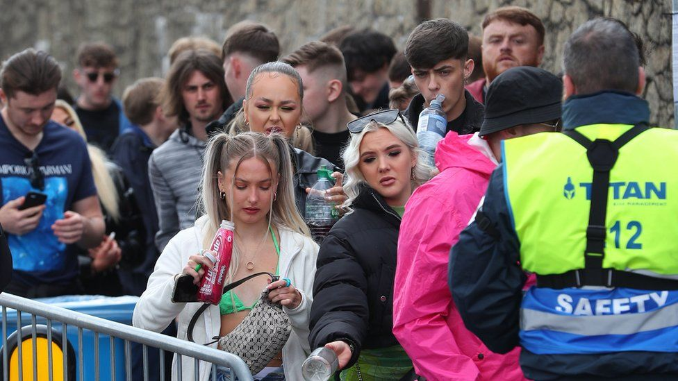 Revellers queue outside the Liverpool venue without masks or social distancing