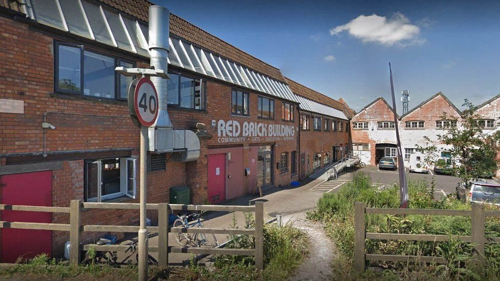 The completion of the Red Brick Building in Glastonbury can now take place