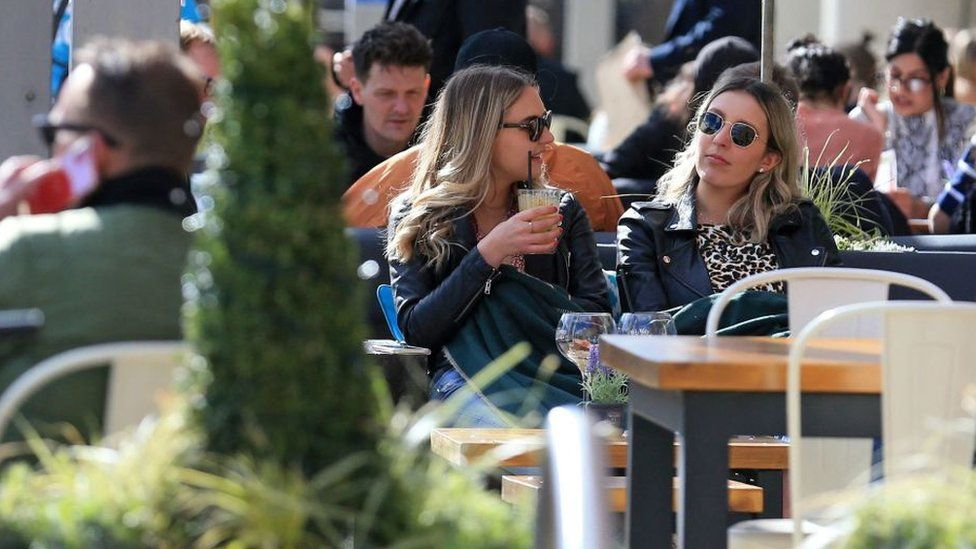 Hospitality customers enjoy an outside seating area whilst drinking