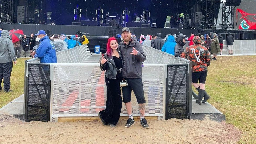 A humanist ceremony was held for Lauren and Jamie McAloon in front of the main stage at the festival
