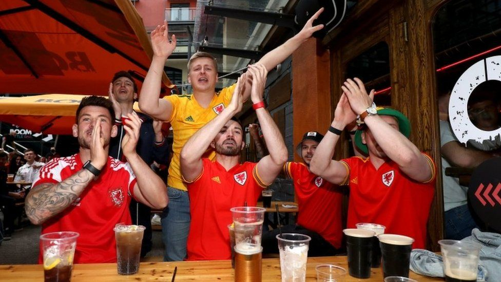 Wales fans react as they watch the Euro 2020 match between Italy and Wales in Cardiff