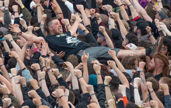 Festival-goer crowdsurfs at Download 2021
