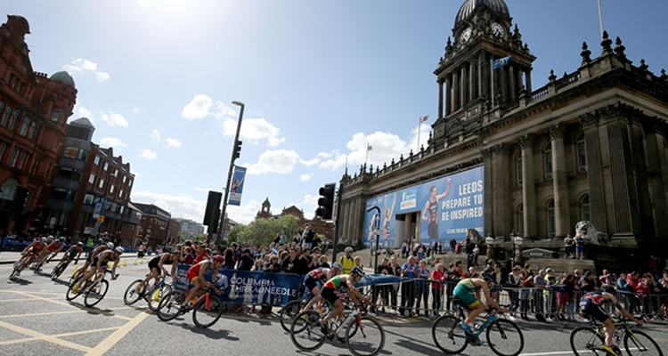 Cyclists come round bend in Leeds city centre