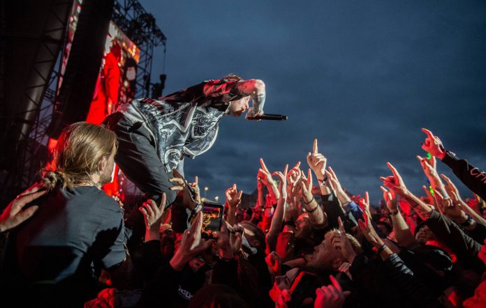 Frank Carter & The Rattlesnakes perform during the Download Pilot Festival at Donington Park on June 18, 2021 in Donington, England. Download Pilot is a 10,000 capacity festival part of a UK government test event to examine how COVID-19 transmission takes place in crowds. Credit: Katja Ogrin/Getty Images.