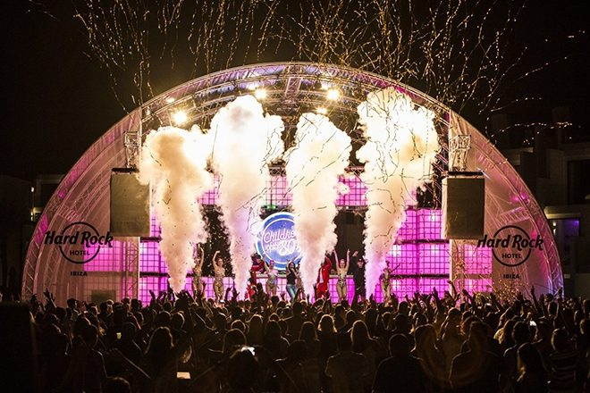 Festival stage with lights and smoke