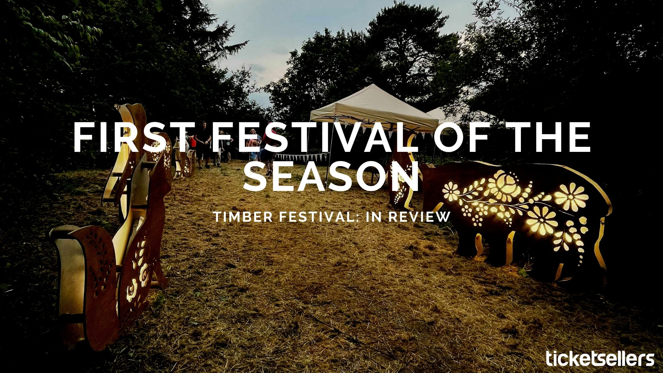 """Photo of walk-way at Timber Festival with light-up animal features, with a text overlay reading """"First festival of the season: Timber Festival in review"""""""