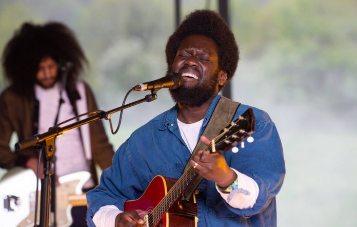 """Michael Kiwanuka performs as part of the Glastonbury Festival Global Livestream """"Live at Worthy Farm"""" at Worthy Farm, Pilton on May 16, 2021 in Glastonbury, England. Credit: Anna Barclay for Glastonbury Festival via Getty Images."""